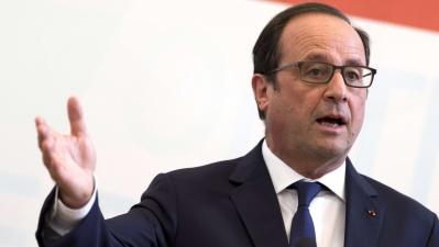 Олланд: квоты не разрешат миграционный кризис