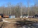 Семья построила маленькую деревню, где у каждого ребенка свой собственный дом