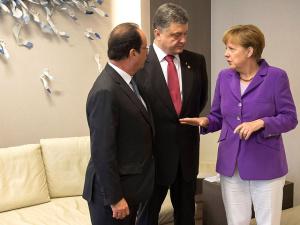 Меркель и Олланд представили Порошенко новый план урегулирования конфликта на Донбассе