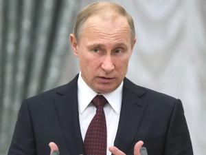 Путин позвонил Олланду и выразил соболезнования в связи с терактом в Париже