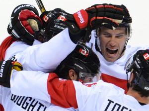 Хоккеисты США и Канады вышли в полуфинал олимпийского турнира