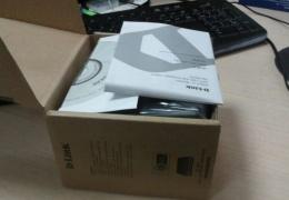 Компактная упаковка диска с драйверами для роутера