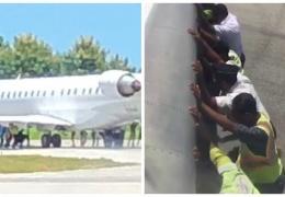 20 мужчин вручную толкают 35-тонный самолет