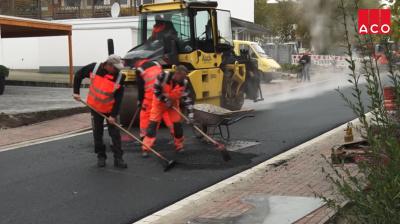 Современные немецкие технологии на страже работ по созданию красивых дорог с люками