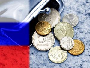 Снижение: евро опустился ниже 57 рублей, доллар - между 45 и 46